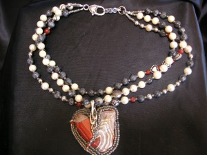 This necklace bead weaving entitled Stories From the Heart is an early work of Mary Ellen Beads Albuquerque and showcases heART centered creativity.