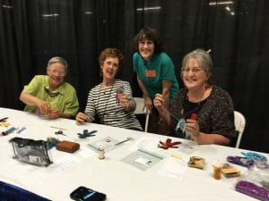 Three participants and the instructor for the Art Doll Class.