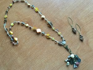 This bead crochet necklace has sentimental charms and is made by Mary Ellen Beads.