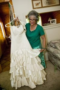 Artist Rose Mary Jameson shows a bridal gown she designed.