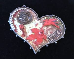 Attitude Red is an example of ice resin art from Mary Ellen Beads Albuuqerque.