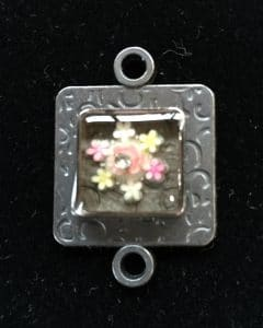 Flower on is an example of Ice Resin Art from Mary Ellen Beads Albuquerque.