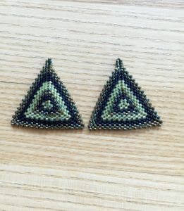 These green triangle earrings are the work of Mary Ellen Beads Albuquerque.