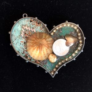 This heart full sand dollar is part of the leather jewelry and ice resin jewelry collection by Mary Ellen Beads Albuquerque.