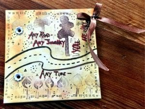 This artist tile portrays a map created by Mary Ellen Beads Albuquerque for the mixed media project of the month.