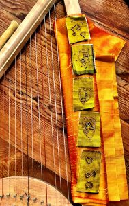 Beyond Brainstorming looks at how beaded rectangles featuring notes and hearts go on the righ.t side of the mini harp made by Mary Ellen Beads Albuquerque.