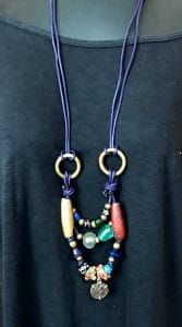 This leather and brass necklace was made by Mary Ellen Beads Albuquerque.