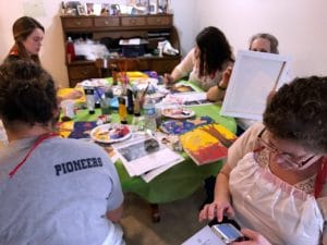 This is a candid shot from Bird Tree Love Paint Party led by Mary Ellen Beads Albuquerque.