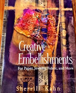 This book, Creative Embellishments by Sherrill Kahn, talks about Angelina Fibers and is recommended by Mary Ellen Beads, Albuquerque.