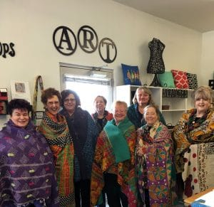 These Kantha Quilt class participants including Mary Ellen of Mary Ellen Beads Albuquerque wrapped themselves in a Quilt.