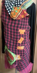This picture shows the hand-stitched rectangles and pockets on a Kantha Vest made by Mary Ellen Beads Albuquerque.