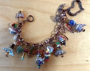 This bracelet celebrated the Go Red event and includes Shrinkets made by Mary Ellen Beads Albuquerque.