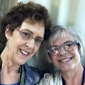 Mary Ellen Merrigan of Mary Ellen Beads Albuquerque poses with Julie Haymaker Thompson after learning that shrinkets showcase creativity.