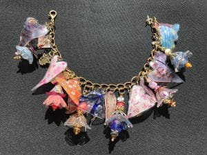 These shrinkets contain positive affirmations from Mary Ellen Beads Albuquerque.