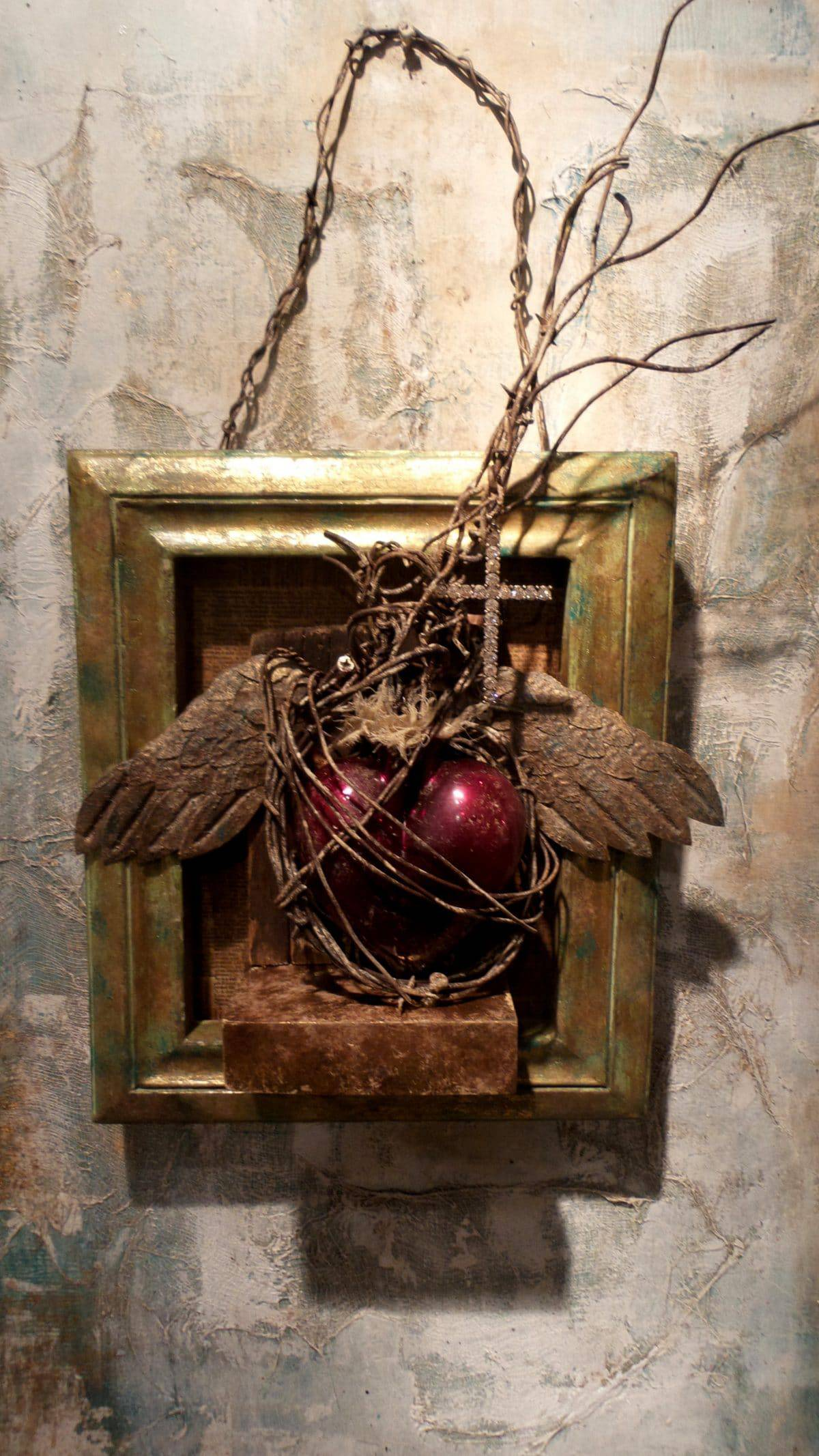 This mixed media assemblage is by Lazaro Iglesias who is being interviewed by Mary Ellen Merrigan