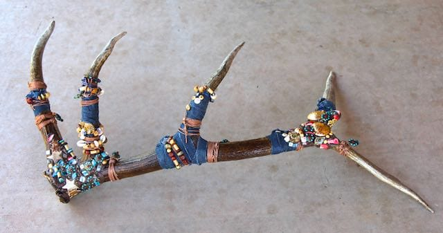This elk horn entitled Denim-n-Doodads was made by Mary Ellen Beads.