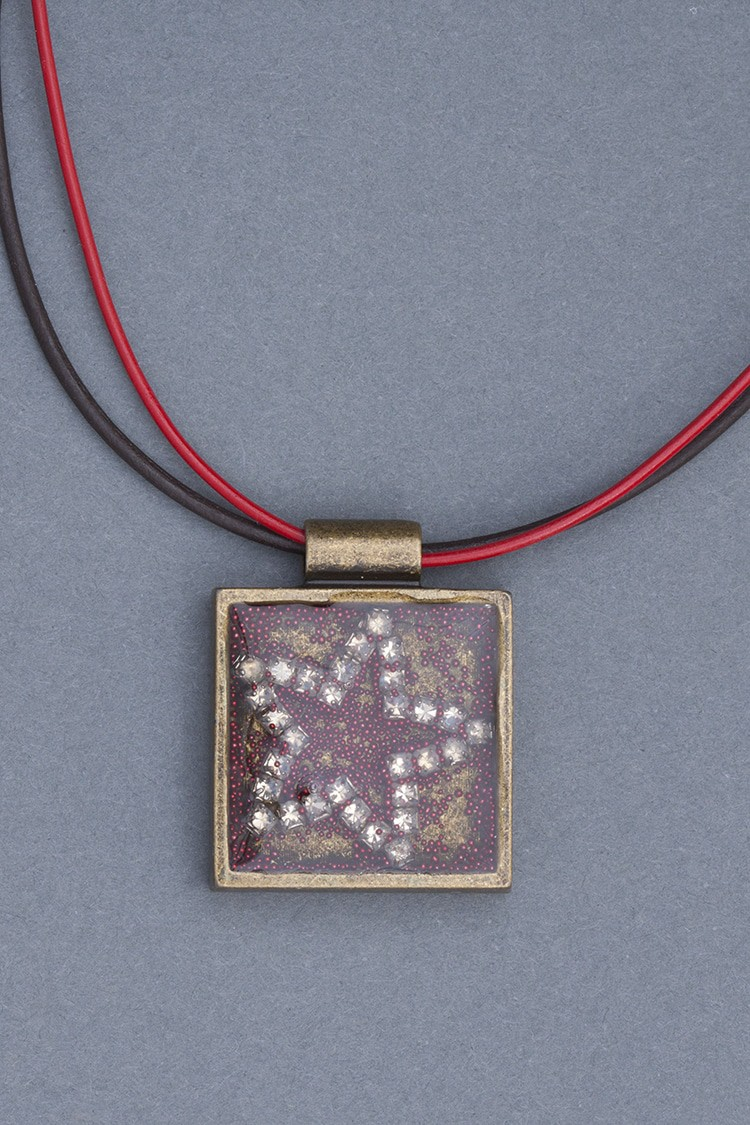This star resin pendant from Mary Ellen Beads will be part of the offerings at the local artisan popup shop in Pottery Barn ABQ Uptown on May 13th.