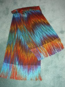 Mary Ellen Beads Albuquerque interviews weaving artist Ruth Ronan about this beautiful shawl from a painted skein converted to a painted warp.