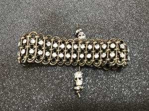 This leather bracelet with cup chain is made by Mary Ellen Merrigan of Mary Ellen Beads Albuquerque.