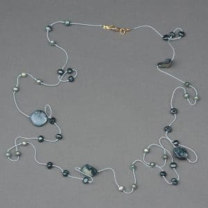 This Barely There necklace by Mary Ellen Bead Albuquerque, shows the beauty of an overhand knot with pearls.