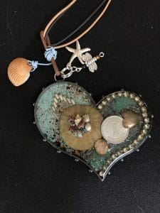 See Ice Resin Pendants like Shells Within Shells from Mary Ellen Beads during the Sandia Heights Artist Studio Tour 2017.