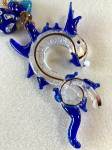 This lampwork glass sea horse is the focal for a free-form peyote necklace by Mary Ellen Beads Albuquerque.