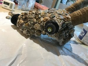 This is the making of the ammonite bead mosaic skull by Mary Ellen Beads Albuquerque.