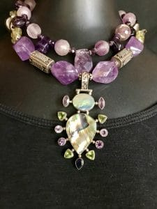This bling story, a set of two amethyst-inspired necklaces, is part of the Holiday Wonders Jewelry Show by Mary Ellen Beads Albuquerque.