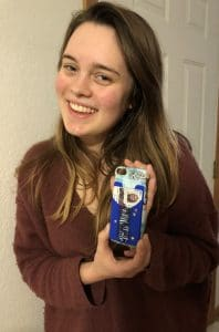 Katie shows her theme for a year, a personalized phone case which she made during craft day with Mary Ellen Beads Albuquerque.
