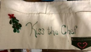 This Kiss the Chef apron was made by Katie during Theme for a Year craft day with Mary Ellen Beads Albuquerque.