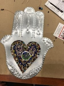 This heart and hands class project is by Barbara R. during a class from Mary Ellen Beads Albuquerque.