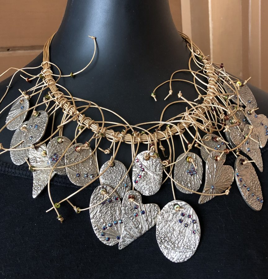 This completed Five Star White Bronze Clay Necklace is by Mary Ellen Merrigan of Mary Ellen Beads Albuquerque