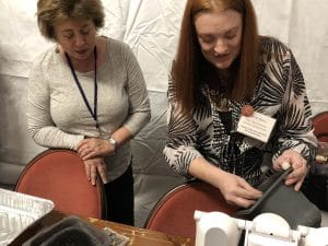 Instructor Carrie Story demonstrates Five Star White Bronze Clay to class participants including Mary Ellen Beads Albuquerque.