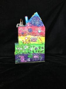 Mary Ellen Beads Albuquerque shows the back of the mixed media art project to benefit OffCenter Arts.