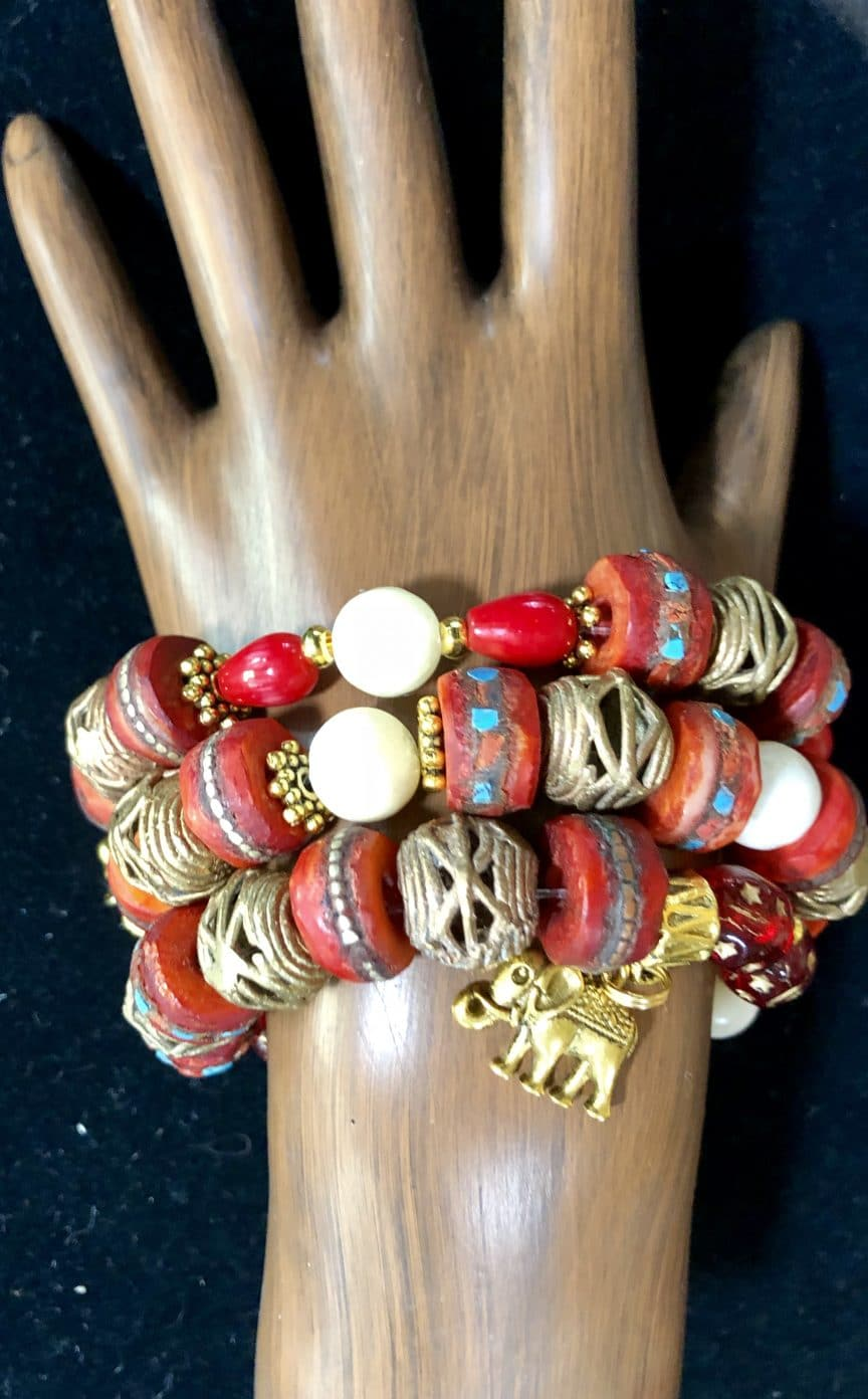 This red yak bone trio contains Nepalanese male beads and was made by Mary Ellen Beads Albuquerque.