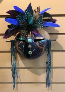 This mask entitled Purple Haze, is the work of gourd artist Barbara Lewis who talked with Mary Ellen Beads Albuuqerque about creativity.