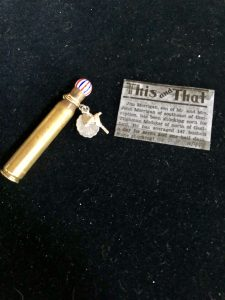 The shell casing and the article about corn shucking were two of the mementos included in the altered tin created by Mary Ellen Beads Albuquerque.