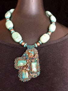 This necklace with its bead weaving of turquoise and copper is part of the symbols and treasures collection for the trunk show from Mary Ellen Beads Albuquerque November 9th at Silk Road Connection.