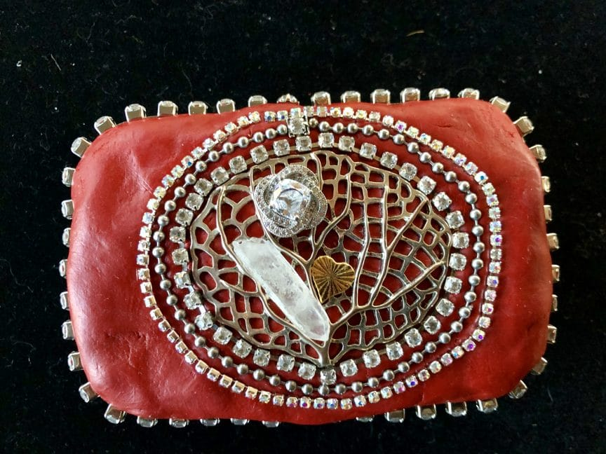This upcycled Altoid box represents Mary Ellen Beads Albuquerque's theme for a year.