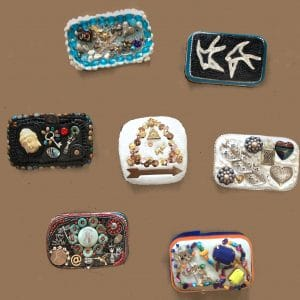 These seven boxes were produced by participants during a Theme for a Year workshop by Mary Ellen Beads Albuquerque.
