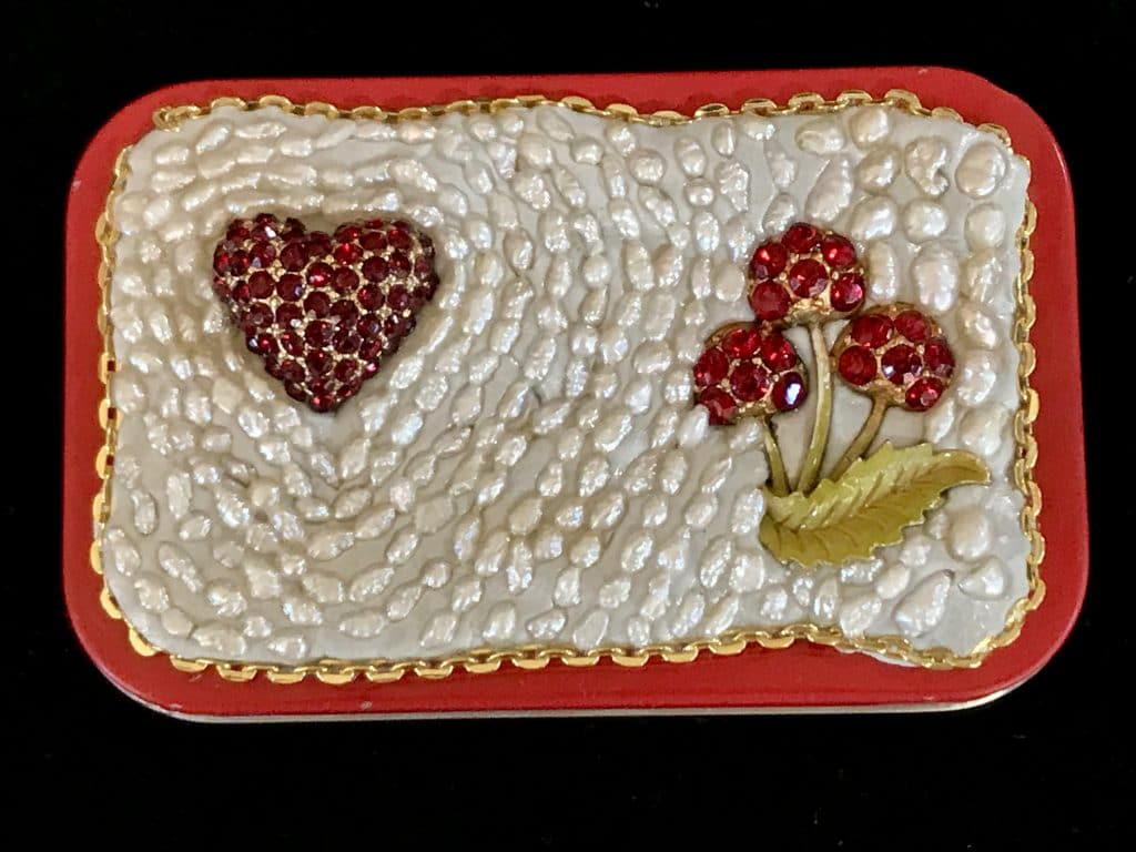 This altoid tin represents hand-to-heart for Mary Ellen Beads Albuquerque.